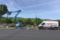Parking Lot Lighting: We have a boom lift!